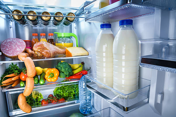 Open refrigerator filled with food – Foto