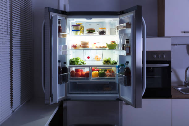 Open Refrigerator In Kitchen Open Refrigerator Full Of Juice And Fresh Vegetables In Kitchen fridge stock pictures, royalty-free photos & images