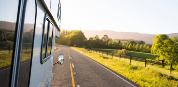Open road with a camper van along a country road stock photo