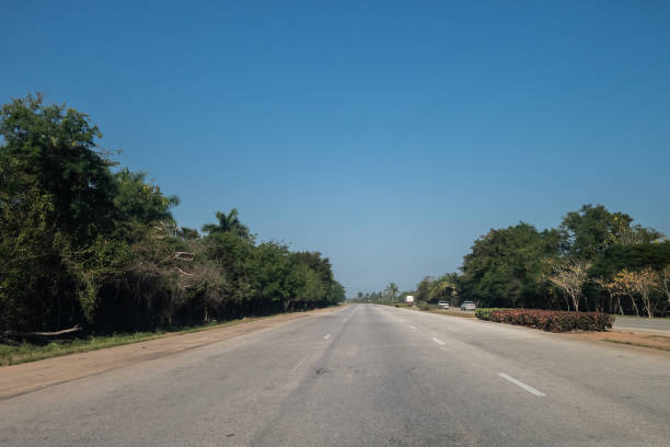 Open road with blue sky in Cuba stock photo