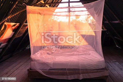 Open room in Costa Rica with mosquito net and orange light