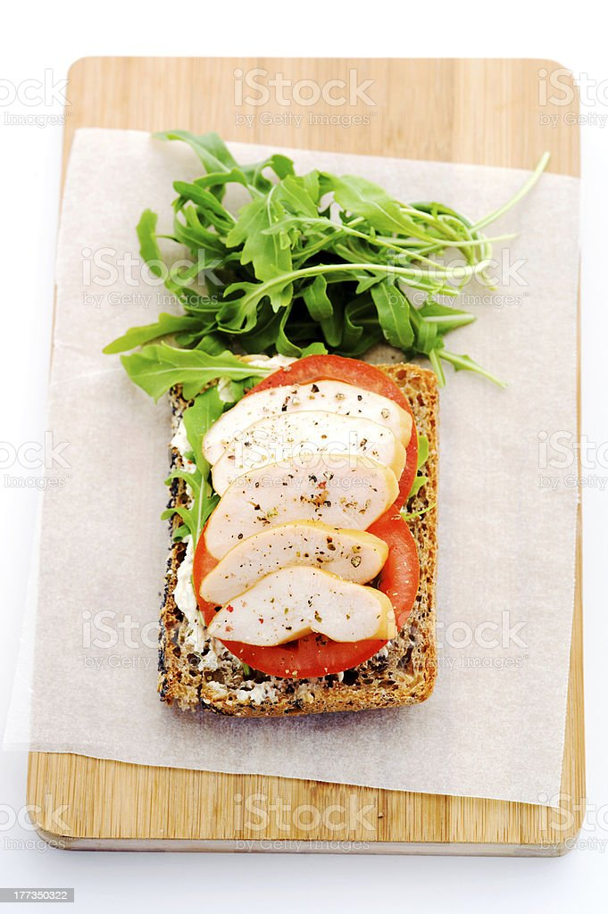 Open sandwich with side salad on wooden board stock photo