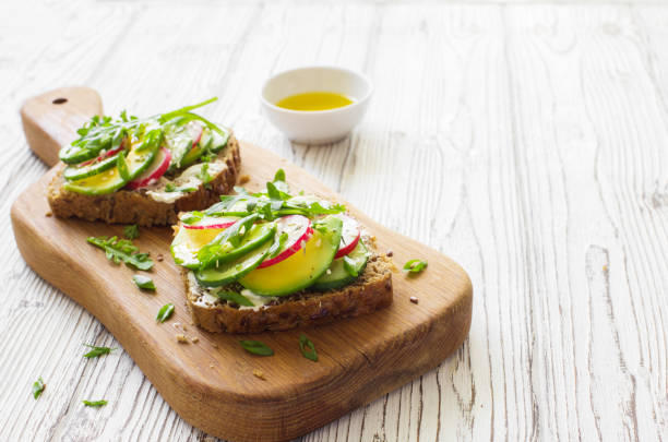 Open sandwiches with fresh vegetables close up stock photo