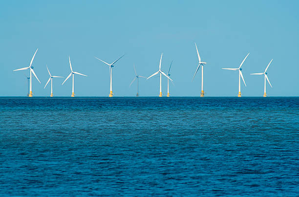 Open sea with wind turbines in the background stock photo