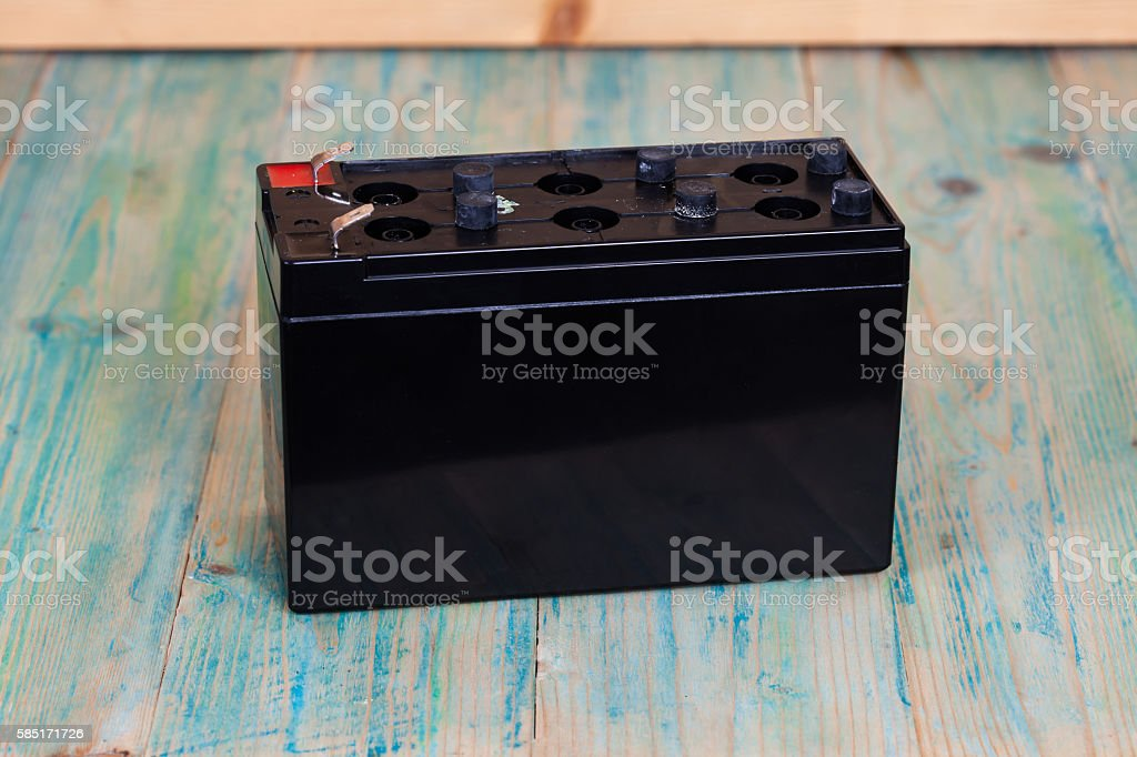 Open Sealed  battery  on wood background ,Seletive focus stock photo