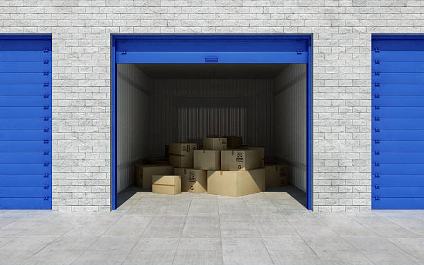 open self storage unit full of cardboard boxes. 3d rendering - entrepôt photos et images de collection