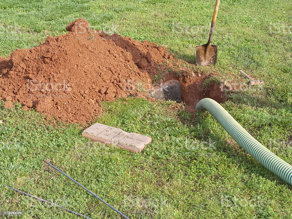 Open Septic Tank In Yard While Bring Pumped Out royalty-free stock photo