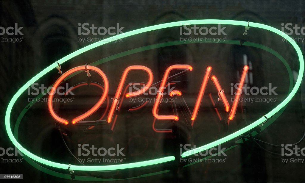 Open, shining neon sign mirroring a church royalty-free stock photo
