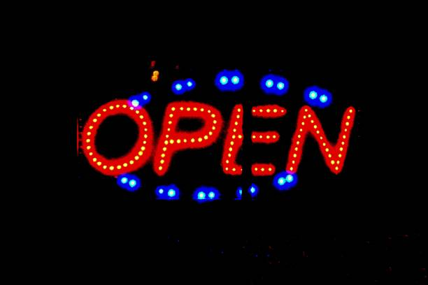 Open sign against a black background stock photo