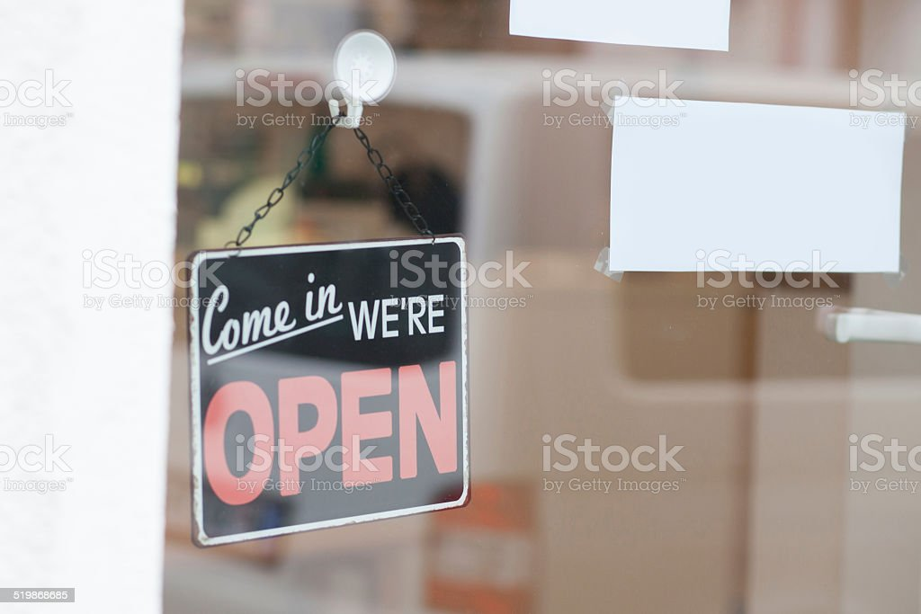 open sign at window shop stock photo