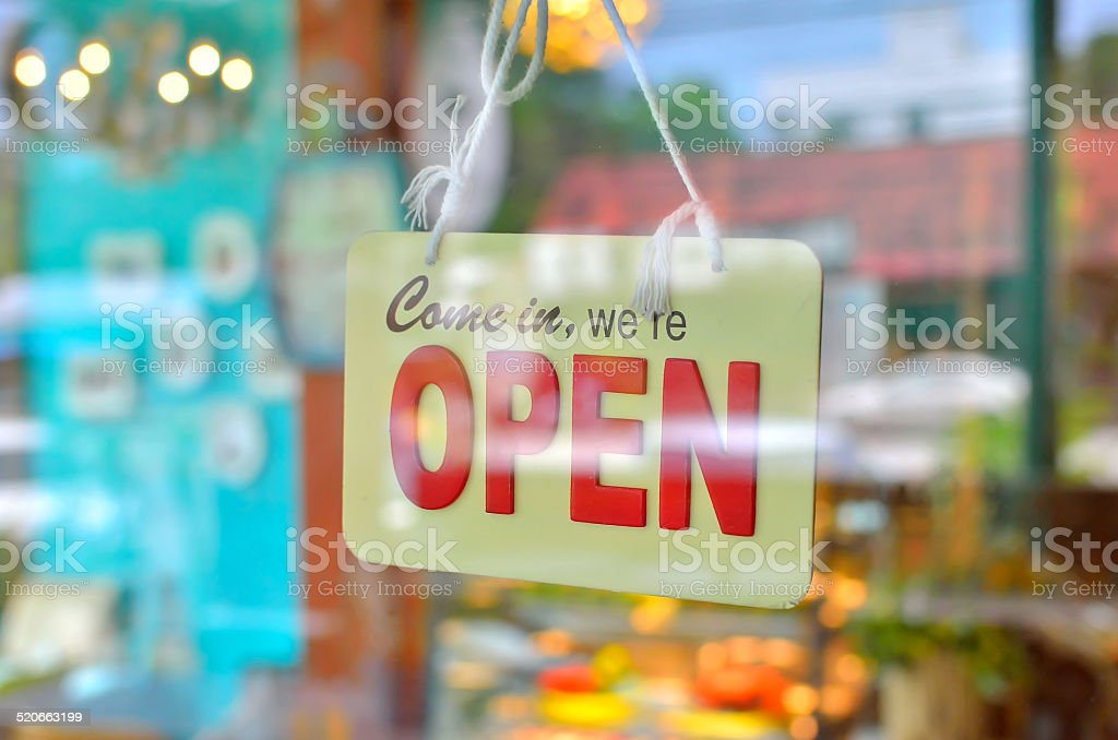 open sign broad through the glass of window stock photo