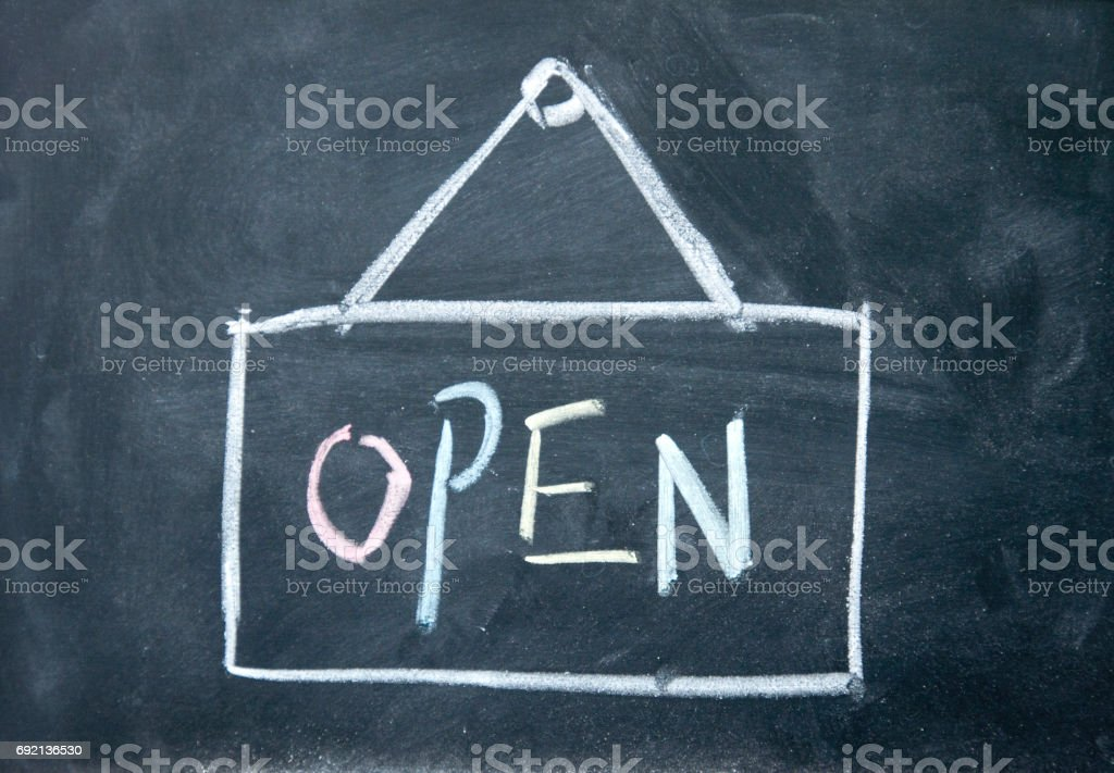 open sign drawn with chalk on blackboard stock photo