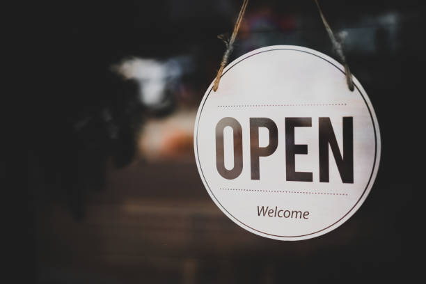 open sign hanging front of cafe with colorful bokeh light abstract background. - cheap stock pictures, royalty-free photos & images