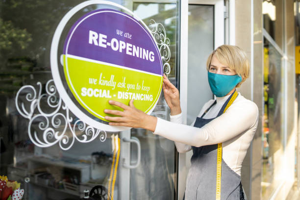 COVID-19. Open sign in a small business shop after Coronavirus pandemic stock photo