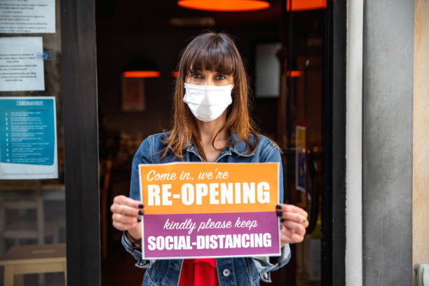Open sign in a small business shop after Covid-19 pandemic stock photo