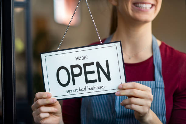 Open sign in a small business shop stock photo