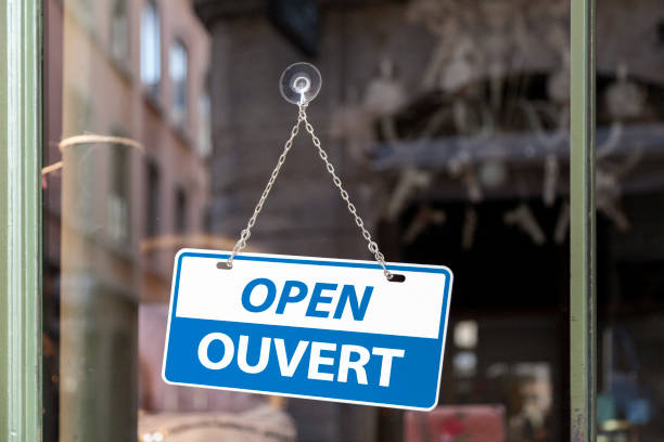 Open sign in English & French stock photo