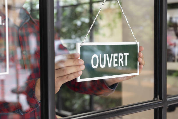Open sign in French language stock photo