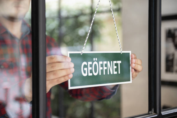 Open sign in German language stock photo