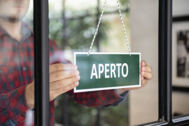 Open sign in Italian language stock photo
