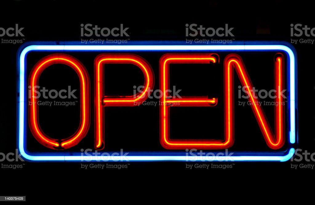 Open sign in neon lights against a black background stock photo