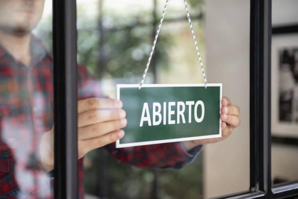 Open sign in Spanish language stock photo