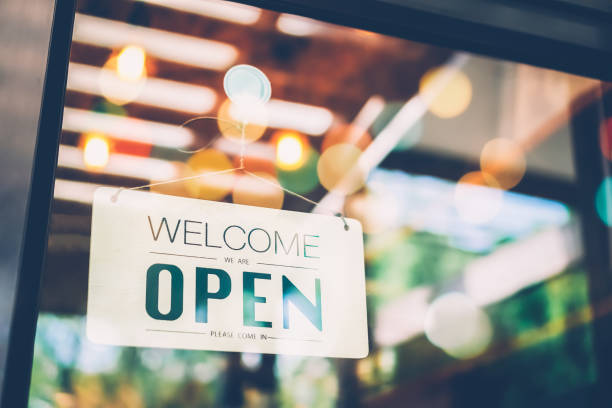 open sign on cafe hang on door at entrance. - store counter stock photos and pictures