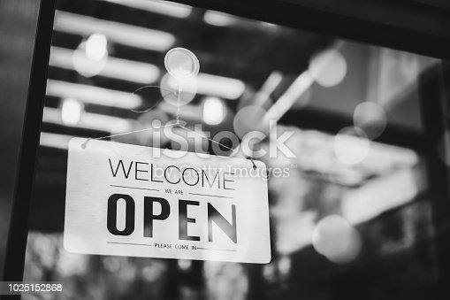 1025152800istockphoto Open sign on cafe hang on door at entrance. 1025152868