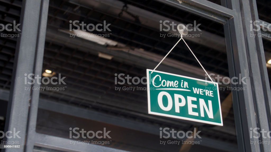 Open sign on the shop's window stock photo
