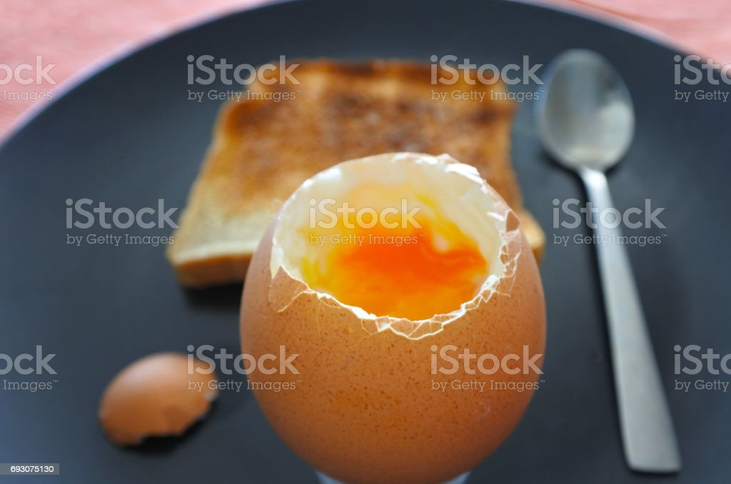 Open soft boiled egg served with a toast stock photo