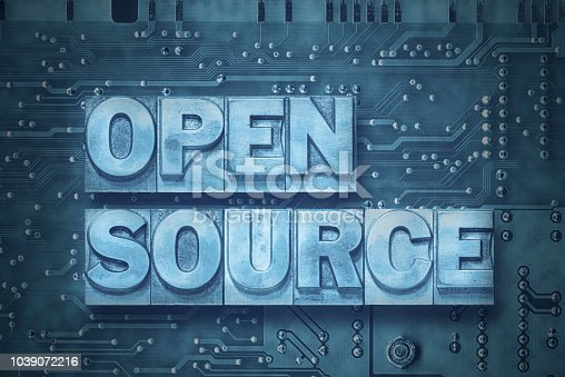 open source phrase made from metallic letterpress blocks on the pc board background