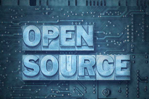 open source - pc board open source phrase made from metallic letterpress blocks on the pc board background ancestry stock pictures, royalty-free photos & images