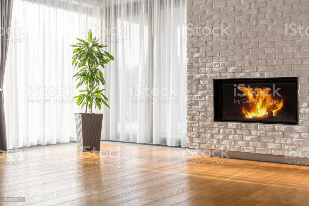 Open space with brick fireplace stock photo