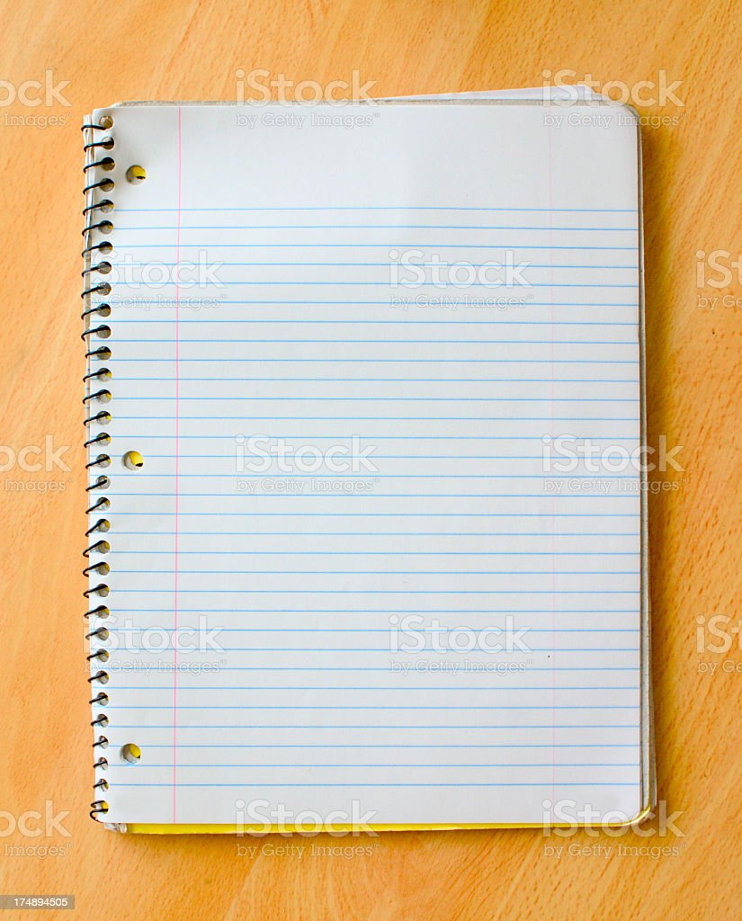 Open spiral bound notebook on desk stock photo