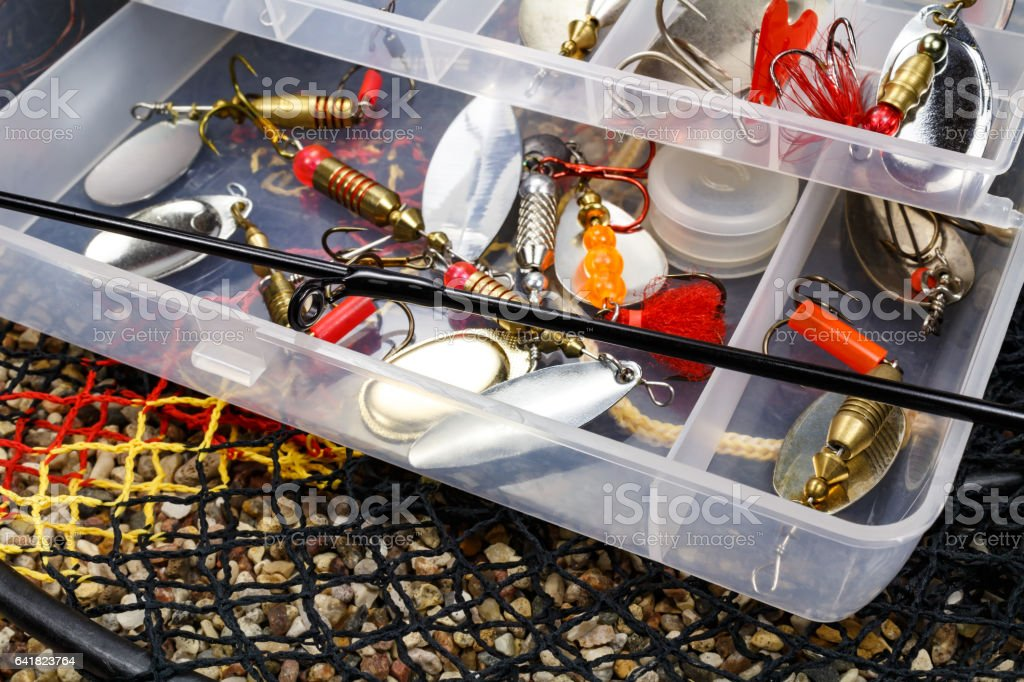Open storage box with accessories for fishing and fishing baits stock photo