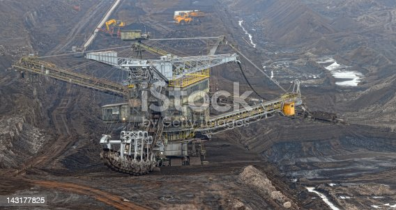 hdr panorama image (made of more than 6 images) of open Coal strip mine with large Bucket-wheel excavator at conveyor belt. German. Eimerkettenbaggerhttp://www.afrost-fotografie.de/add/quarry.jpg