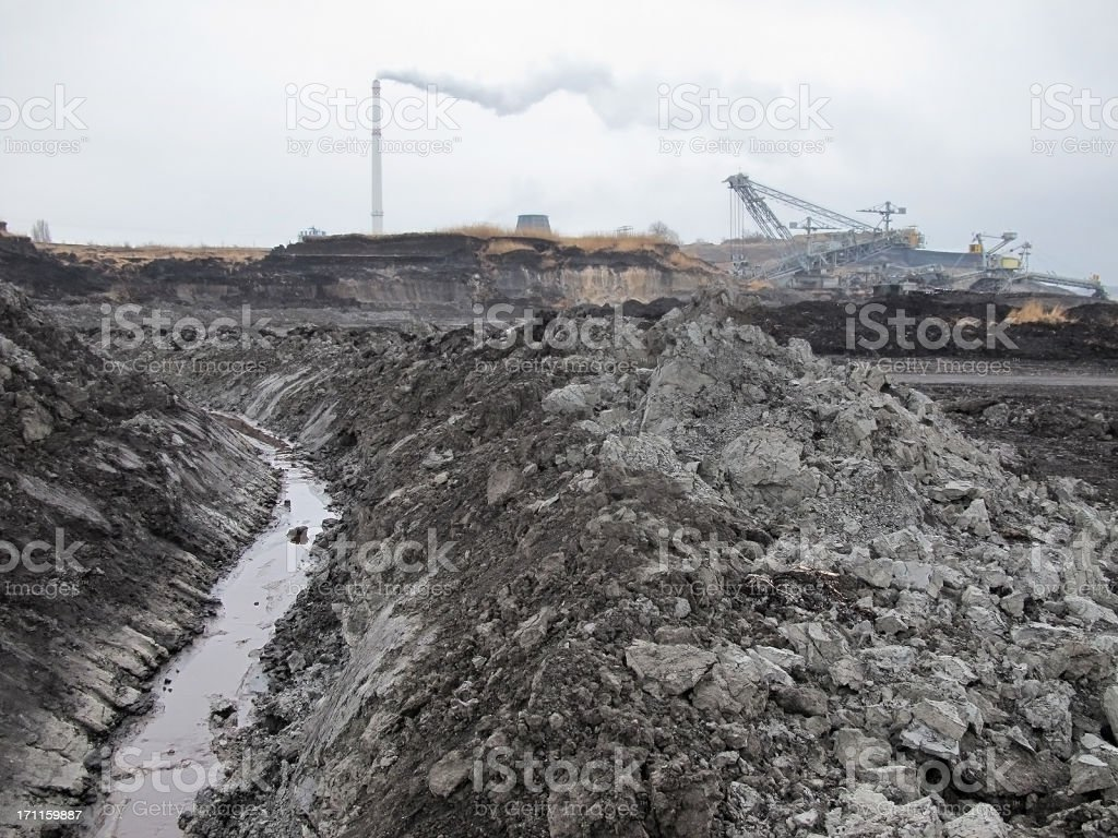 open Strip Coal mine with smoke stake fumes stock photo
