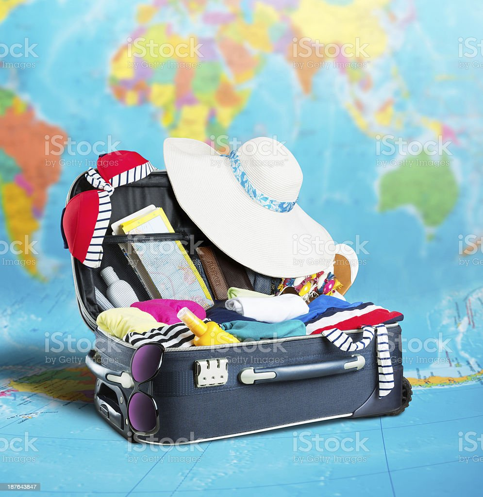 Open suitcase full of clothing royalty-free stock photo