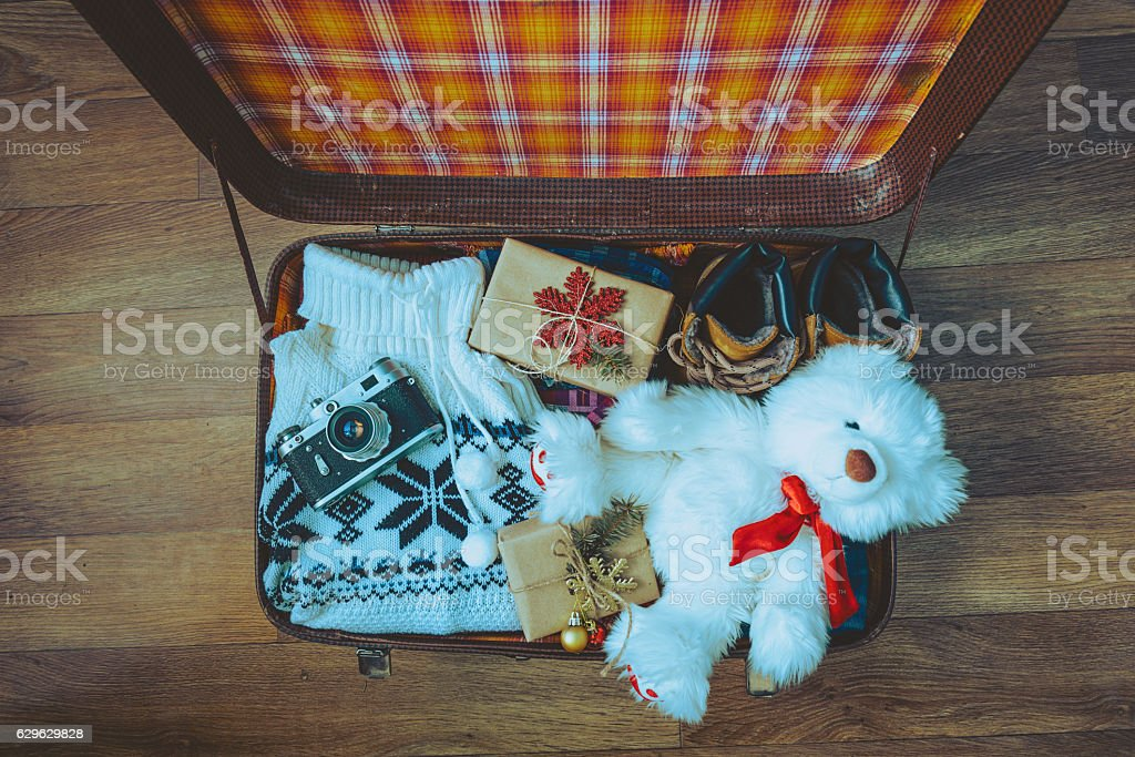 Open suitcase with casual clothes stock photo