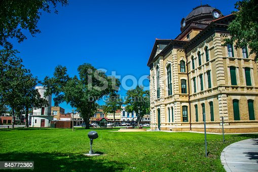 1024248138istockphoto Open Sunny grass covered field in front of Columbus Texas City County Courthouse the Town Square of the Historic small Town of Texas along the Colorado River South west of Houston 845772360