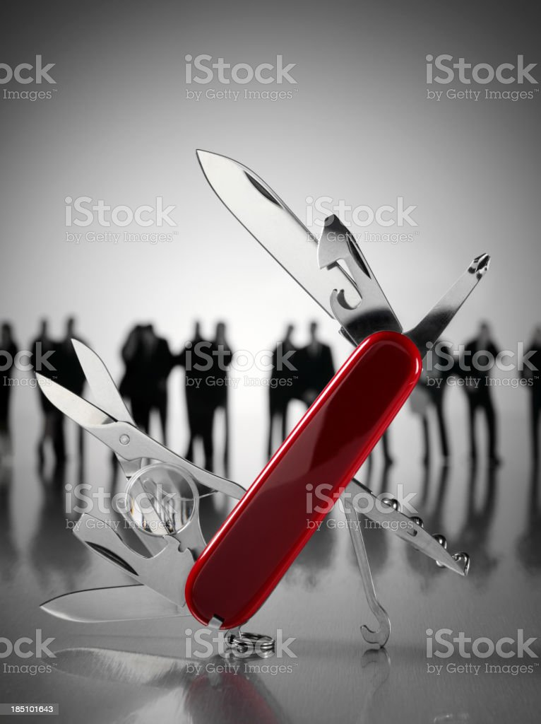 Open Swiss Army Knife with Business People royalty-free stock photo