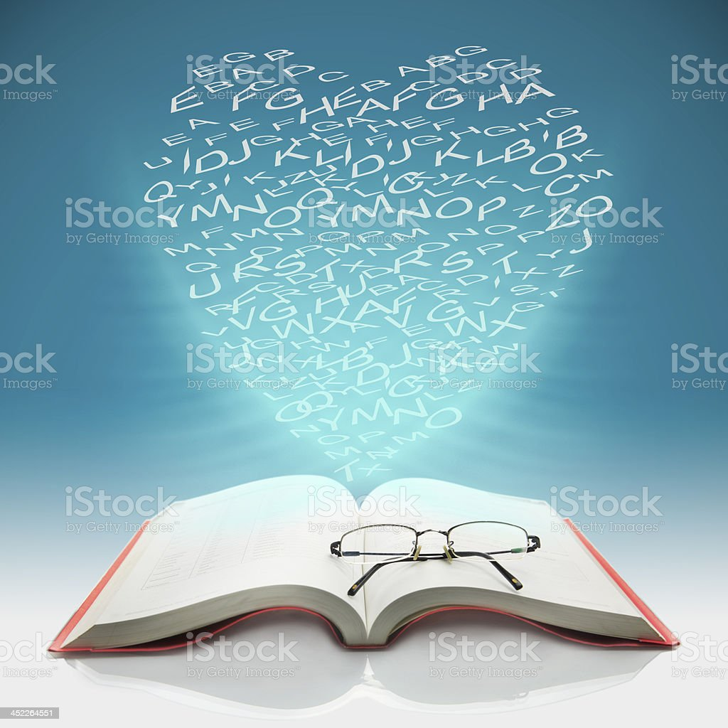 Open the book to have heart shaped letters royalty-free stock photo