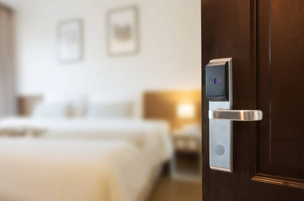 Open the door Open the door using a keycard system. cardkey stock pictures, royalty-free photos & images