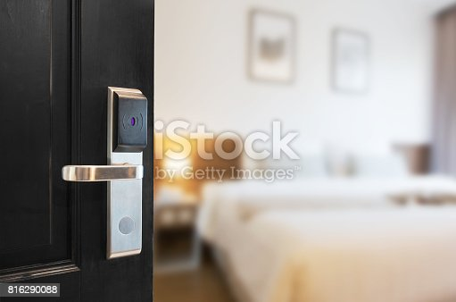 Open the door using a keycard system.