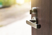 istock Open the modern wooden door 672475256