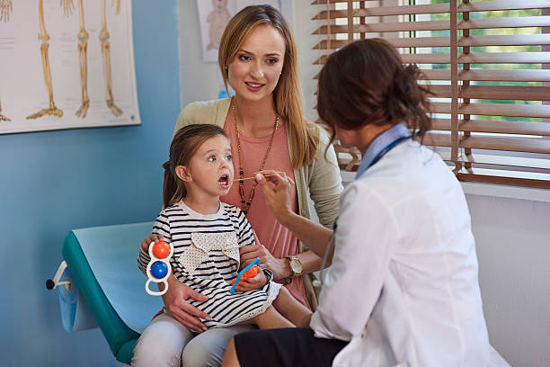 open the mouth. let's check your throat - mom spying stock photos and pictures