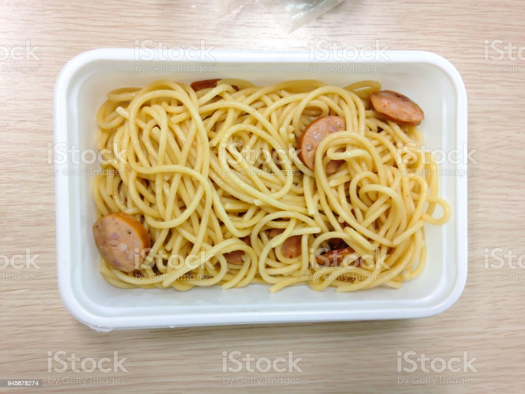 Open the takeaway plastic lunch box on wood table stock photo