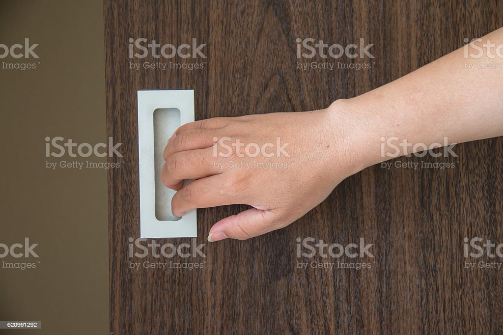 Open the wardrobe woman's hand stock photo