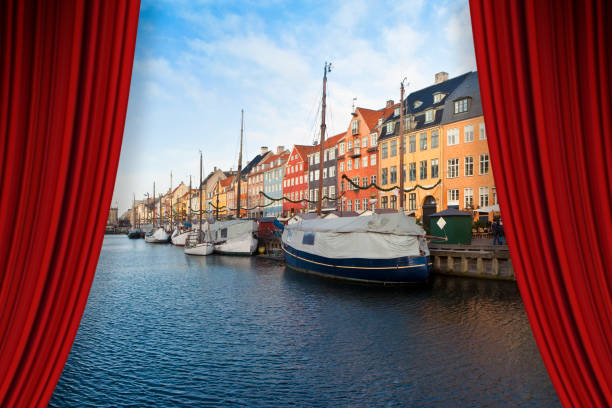 open theater red curtains against nyhavn city during the christmas holidays - (europe - denmark - copenhagen) - concept image - sipario foto e immagini stock