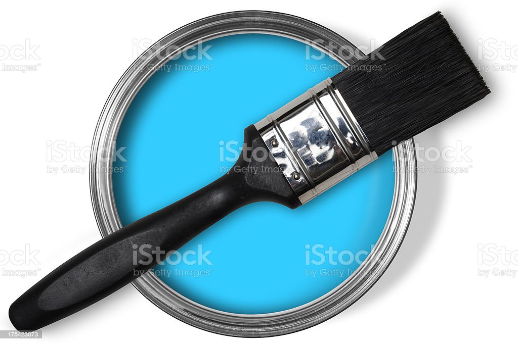 Open tin of blue paint, brush on top on white stock photo